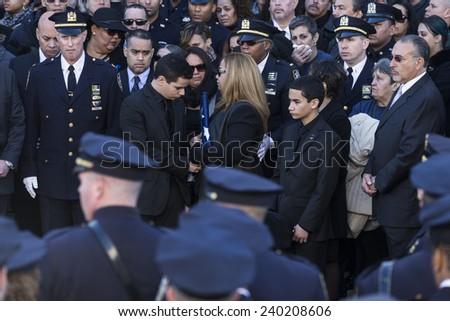 NEW YORK, NY - DECEMBER 27, 2014: Maritza Ramos, Justin Ramos and Jared Ramos hold colors at  Christ Tabernacle Church for the funeral of slain New York City Police Officer Rafael Ramos - stock photo