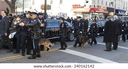 NEW YORK, NY - DECEMBER 27, 2014: Police officers from around the country gather outside of Christ Tabernacle Church for the funeral of slain New York City Police Officer Rafael Ramos