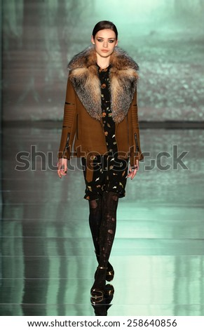 NEW YORK, NY - FEBRUARY 13: A model walks runway at the Nicole Miller fashion show during MBFW Fall 2015 at Lincoln Center on February 13, 2015 in NYC  - stock photo