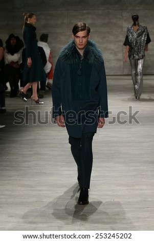 NEW YORK, NY - FEBRUARY 14: A model walks the runway at Son Jung Wan fashion show during Mercedes-Benz Fashion Week Fall 2015 at Lincoln Center on February 14, 2015 in New York City