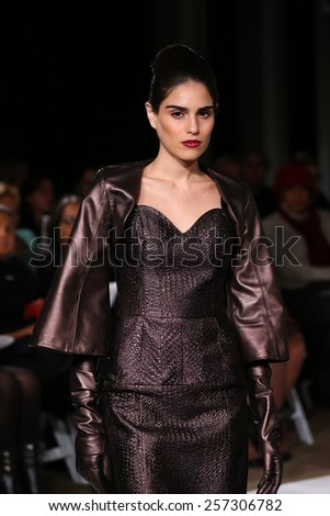 NEW YORK, NY - FEBRUARY 18: A model walks the runway at the B Michael America fashion show during MBFW Fall at New York Public Library on February 18, 2015 in NYC - stock photo