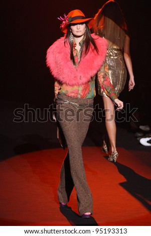 NEW YORK, NY - FEBRUARY 13: A model walks the runway at the Betsey Johnson Fall 2012 fashion show during Mercedes-Benz Fashion Week at Lincoln Center on February 13, 2012 in New York City. - stock photo