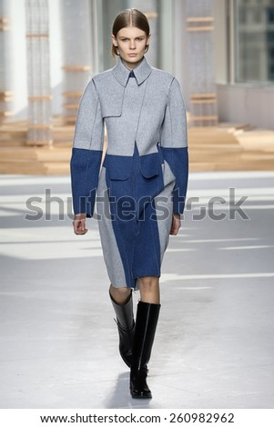 NEW YORK, NY - FEBRUARY 18: A model walks the runway at the Boss Womens fashion show during Mercedes-Benz Fashion Week Fall on February 18, 2015 in NYC. - stock photo