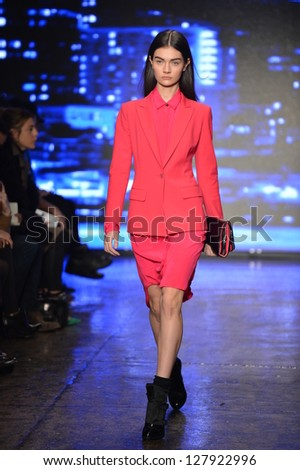 NEW YORK, NY - FEBRUARY 10: A model walks the runway at the DKNY Fall Winter 2013 fashion show during Mercedes-Benz Fashion Week on February 10, 2013, NYC. - stock photo