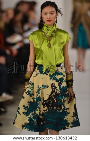 NEW YORK, NY - FEBRUARY 12: A model walks the runway at the Oscar De La Renta Fall 2013 fashion show during Mercedes-Benz Fashion Week at 11 West 42nd Street on February 12, 2013 in New York City. - stock photo