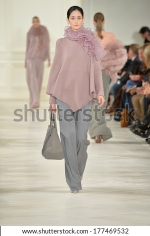 NEW YORK, NY - FEBRUARY 13: A model walks the runway at the Ralph Lauren fashion show during Mercedes-Benz Fashion Week Fall 2014 on February 13, 2014 in New York City.