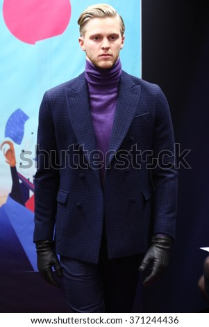NEW YORK, NY - FEBRUARY 01: A model walks the runway at the Stephen F fashion show during New York Fashion Week Men's Fall/Winter 2016 on February 1, 2016 in New York City. - stock photo
