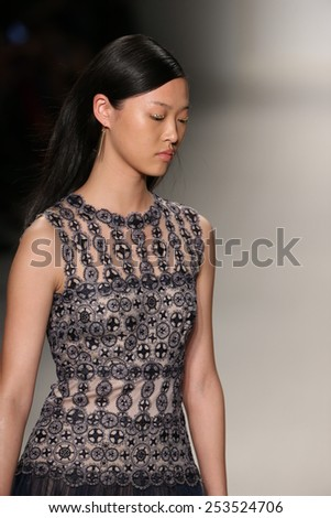 NEW YORK, NY - FEBRUARY 12: A model walks the runway at the Tadashi Shoji show during Mercedes-Benz Fashion Week Fall 2015 at The Salon at Lincoln Center on February 12, 2015 in New York City.