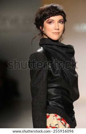NEW YORK, NY - FEBRUARY 19: A model walks the runway in a design by Altaf Maaneshia at the New York Life fashion show during MBFW Fall 2015 at Lincoln Center on February 19, 2015 in NYC.  - stock photo