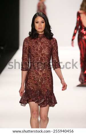 NEW YORK, NY - FEBRUARY 19: A model walks the runway in a Mimi Tran design at the Art Hearts Fashion show during MBFW Fall 2015 at Lincoln Center on February 19, 2015 in NYC