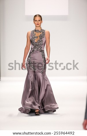NEW YORK, NY - FEBRUARY 19: A model walks the runway in a Walter Mendez design at the Art Hearts Fashion show during MBFW Fall 2015  at Lincoln Center on February 19, 2015 in NYC. - stock photo