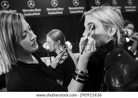 New York, NY - February 13, 2015: Becca Horn prepares backstage at the Nicole Miller Fall 2015 fashion show during Mercedes-Benz Fashion Week at The Salon at Lincoln Center