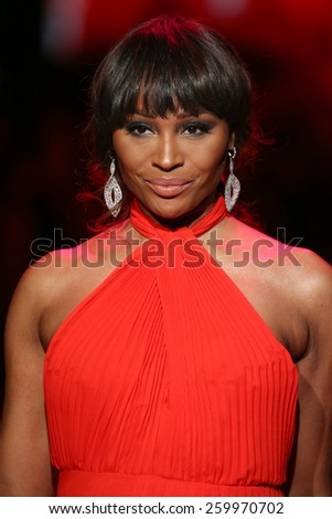 NEW YORK, NY - FEBRUARY 12: Cynthia Bailey walks the runway at the Go Red For Women Red Dress Collection 2015 fashion show during MBFW Fall 2015 at Lincoln Center on February 12, 2015 in NYC - stock photo