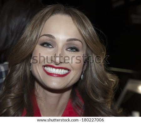 NEW YORK, NY - FEBRUARY 06, 2014: Giada De Laurentiis prepares backstage for The Heart Truth's Red Dress Collection at Mercedes-Benz Fall/Winter 2014 Fashion Week at Lincoln Center