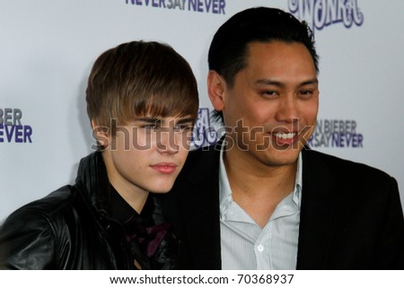 "NEW YORK, NY - FEBRUARY 02: Justin Bieber and director Jon Chu attend the ""Justin Bieber: Never Say Never"" New York movie premiere at the Regal E-Walk 13 Theater on February 2, 2011 in New York City. - stock photo"