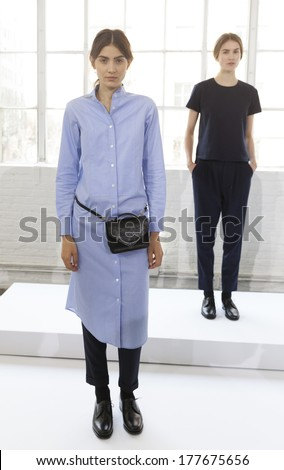 NEW YORK, NY - FEBRUARY 12, 2014: Models show off dresses for presentation by Steven Alan at Fall/Winter 2014 Fashion week in Industria Super Studio