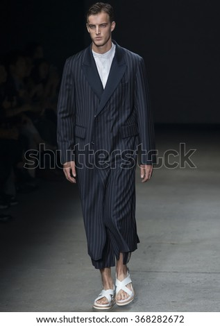 NEW YORK, NY - JULY 14, 2015: James Smith walks the runway during the Concept Korea show at New York Fashion Week Men's S/S 2016 at Skylight Clarkson Sq - stock photo