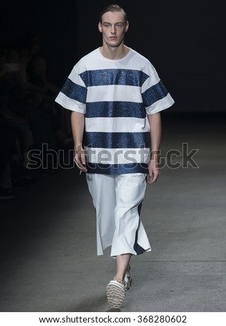 NEW YORK, NY - JULY 14, 2015: Roberto Sipos walks the runway during the Concept Korea show at New York Fashion Week Men's S/S 2016 at Skylight Clarkson Sq - stock photo