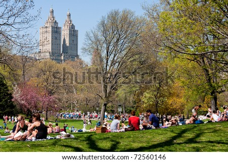 NEW YORK, NY - JUNE 15: New Yorkers relax at Central Park to enjoy the first sunbath of the season June 15, 2010 in Manhattan. - stock photo