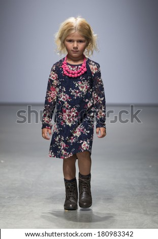 New York, NY - March 08, 2014: Girl walks runway for Imoga by Heajung Chung at Vogue Bambini petiteParade Kids Fashion Week at Center 545