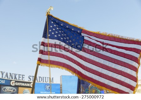 New York, NY - May 3, 2015: American Flag at opening ceremony before MLS game between New York Football Club and Seattle Sounders FC at Yankee Stadium - stock photo