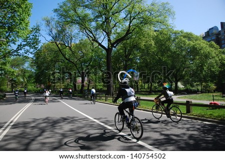 NEW YORK, NY - MAY 5: Bikers ride in Central Park during the 2013 TD 5 Boro Bike Tour on May 5th, 2013 in New York, New York. - stock photo