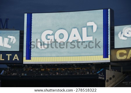 New York, NY - May 15, 2015: Celebration message on huge display after goal by NYCFC Mehdi Ballouchy during the game between New York City Football Club and Chicago Fire FC at Yankee Stadium - stock photo