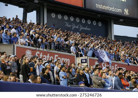New York, NY - May 3, 2015: Fans of NYFC in light blue colors during the game between New York Football Club and Seattle Sounders FC at Yankee Stadium - stock photo