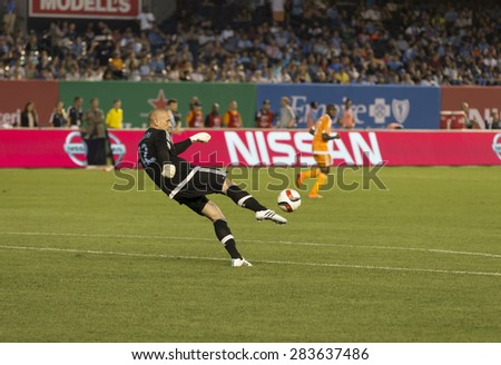 New York, NY - May 30, 2015: New York City Football Club Goalkeeper Josh Saunders send ball into the field during the game between New York City Football Club and Houston Dynamo at Yankee Stadium - stock photo