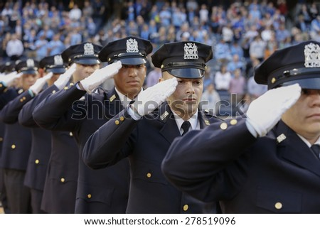 New York, NY - May 15, 2015:  NYPD Honor guards attend game between New York City Football Club and Chicago Fire FC at Yankee Stadium - stock photo