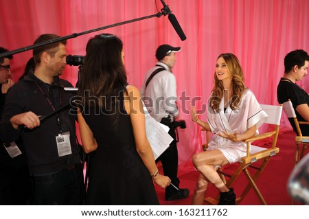 NEW YORK, NY - NOVEMBER 13: Behati Prinsloo during interviews process backstage at the 2013 Victoria's Secret Fashion Show at Lexington Avenue Armory on November 13, 2013 in New York City.  - stock photo