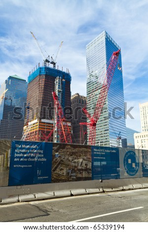 NEW YORK, NY - NOVEMBER 14: Cranes are working at the site of ground-zero to build new skyscrapers, on November 14, 2010 in New York. Ground-zero where the terrorist attacks took place on 11/09/01. - stock photo