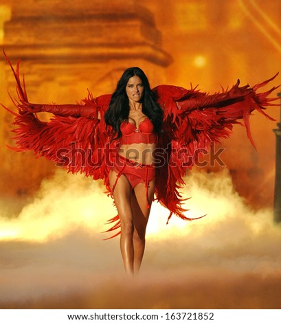 NEW YORK, NY - NOVEMBER 13: Model Adriana Lima walks the runway at the 2013 Victoria's Secret Fashion Show at Lexington Avenue Armory on November 13, 2013 in New York City.  - stock photo