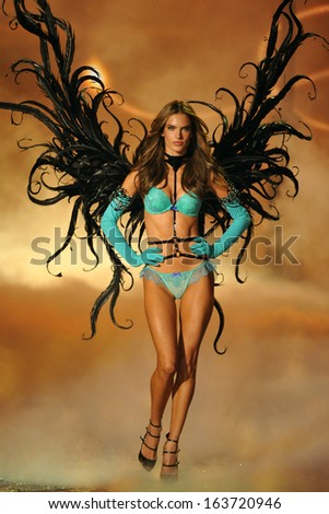 NEW YORK, NY - NOVEMBER 13: Model Alessandra Ambrosio walks in the 2013 Victoria's Secret Fashion Show at Lexington Avenue Armory on November 13, 2013 in New York City. - stock photo