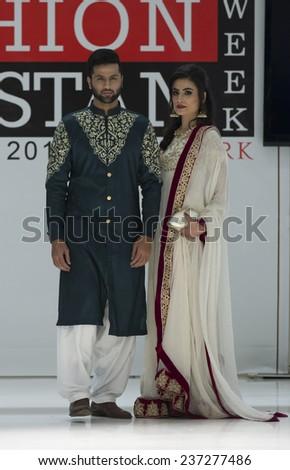 New York, NY - November 28, 2014: Model walks runway for NKC Narjis Kamran Collection at Pakistan Fashoin Week in Studio 05 - stock photo