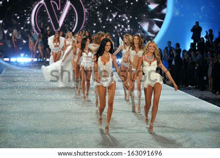 NEW YORK, NY - NOVEMBER 13: Models walk the runway finale at the 2013 Victoria's Secret Fashion Show at Lexington Avenue Armory on November 13, 2013 in New York City. - stock photo