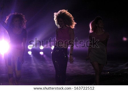 NEW YORK, NY - NOVEMBER 13: Music band Neon Jungle performs on the runway at the 2013 Victoria's Secret Fashion Show at Lexington Avenue Armory on November 13, 2013 in New York City.