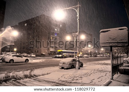 NEW YORK, NY - NOVEMBER 07: Snow falls on damaged cars and streets as a Nor'Easter arrives just ten days after Superstorm Sandy ravaged the tri-state area.  November 7, 2012 in the Brooklyn, NY - stock photo