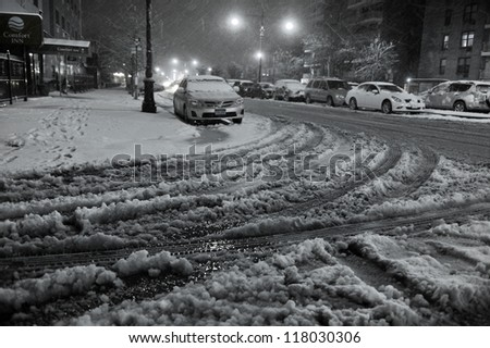 NEW YORK, NY - NOVEMBER 07: Snow falls on demaged cars and streets as a Nor'Easter arrives in the Sheepshadbay neighborhood just ten days after Superstorm Sandy.  November 7, 2012 in the Brooklyn, NY - stock photo
