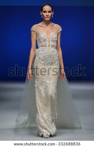 NEW YORK, NY - OCTOBER 11: A model walks at Shlomit Azrad Bridal Fall/Winter 2016 Runway Show at The Pier94 on October 11, 2015 in New York City. - stock photo