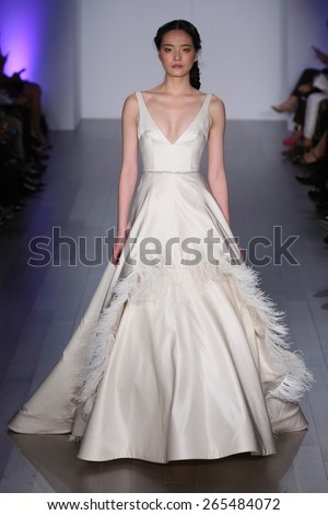 NEW YORK, NY - OCTOBER 10: A model walks runway at Jim Hjelm fashion show during Fall 2015 Bridal Collection on October 10, 2014 in NYC.