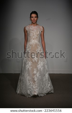 NEW YORK, NY - OCTOBER 12: A model walks the runway at the Anna Maier / Ulla-Maija Couture Fall 2014 Bridal collection show at the Hilton New York on October 12, 2014 in New York City. - stock photo