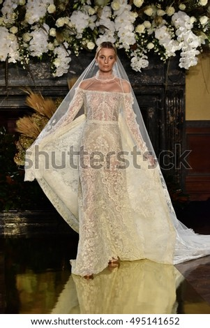 NEW YORK, NY - OCTOBER 6: A model walks the runway at the YolanCris Fall 2017 Bridal collection show on October 6, 2016 in New York City.