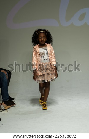 NEW YORK, NY - OCTOBER 19: A model walks the runway during the Clarks preview at petitePARADE Kids Fashion Week at Bathhouse Studios on October 19, 2014 in New York City.