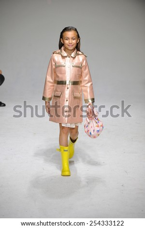 NEW YORK, NY - OCTOBER 18: A model walks the runway during the Oil & Water preview at petitePARADE / Kids Fashion Week at Bathhouse Studios on October 18, 2014 in New York City. - stock photo