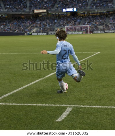 New York, NY - October 25, 2015: Andrea Pirlo (21) of BYC FC performs free kick during match between NYC FC & New England Revolution at Yankee Stadium - stock photo
