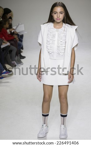 NEW YORK, NY - OCTOBER 19, 2014: Coco Rohatyn walks the runway during the Bonnie Young preview at petitePARADE - Kids Fashion Week at Bathhouse Studios
