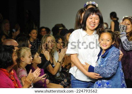 NEW YORK, NY - OCTOBER 18: Designer Erica Kim walk the runway with models during the Parsons preview at petite PARADE Kids Fashion Week at Bathhouse Studios on October 18, 2014 in New York City.