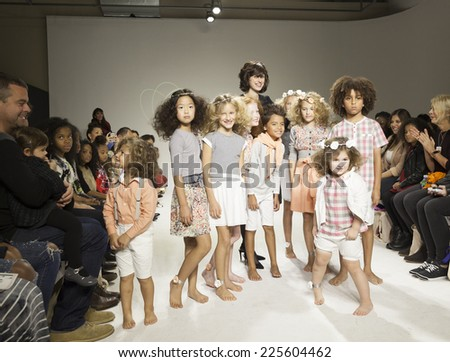 New York, NY - October 19, 2014: Designer Rany Mendlovic and kids walk runway for PetiteParade Kids Fashion week at Bath House Studios - stock photo