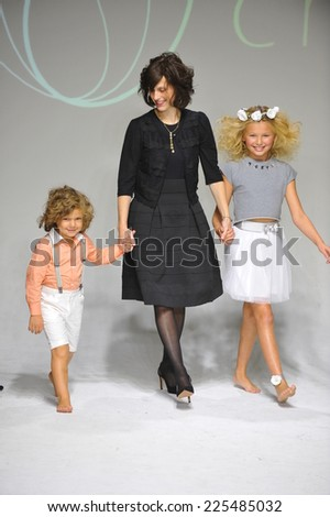 NEW YORK, NY - OCTOBER 19: Designer Rany Mendlovic walks the runway with models during the Charm preview at petitePARADE Kids Fashion Week at Bathhouse Studios on October 19, 2014 in New York City.  - stock photo